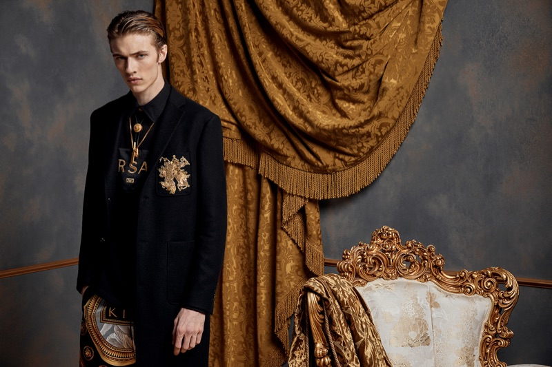 Embracing a tailored look, Lucky Blue Smith dons pieces from the Kith x Versace collection.