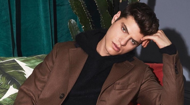 Antonino Russo showcases Valentine's Date inspiration with a single-breasted coat, brushed texture hoodie, and jeans from YOOX.