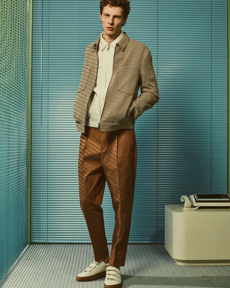 Embracing shades of brown, Tim Schuhmacher wears Zara Man.