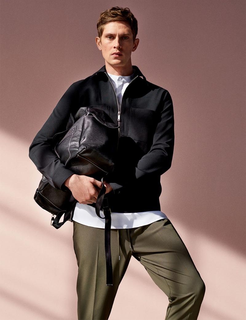 Mathias Lauridsen dons a blouson jacket with drawstring pants from Zara.