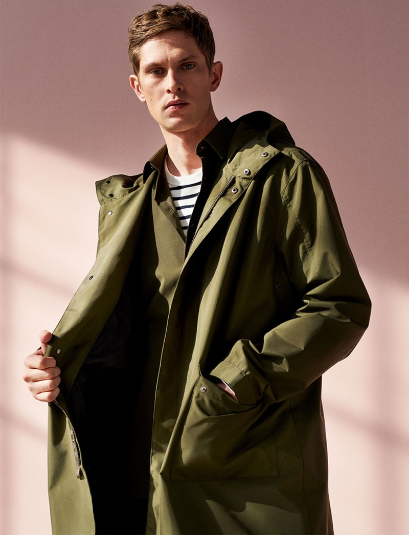 Model Mathias Lauridsen sports a parka with a striped pullover by Zara.