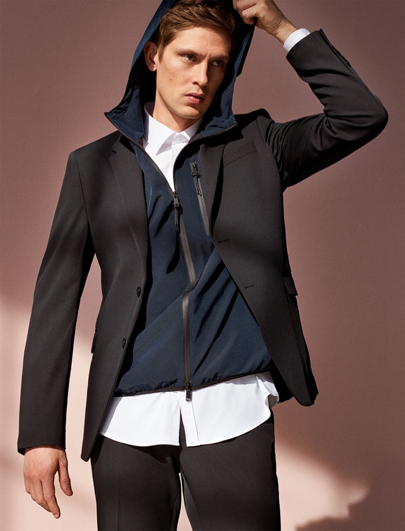 Going sporty, Mathias Lauridsen dons a hooded jacket with a suit.