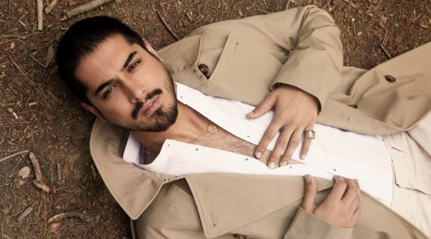 Starring in a new photo shoot, Avan Jogia sports a H&M trench with a SCYLT shirt, COS trousers, and a ring by Topman.
