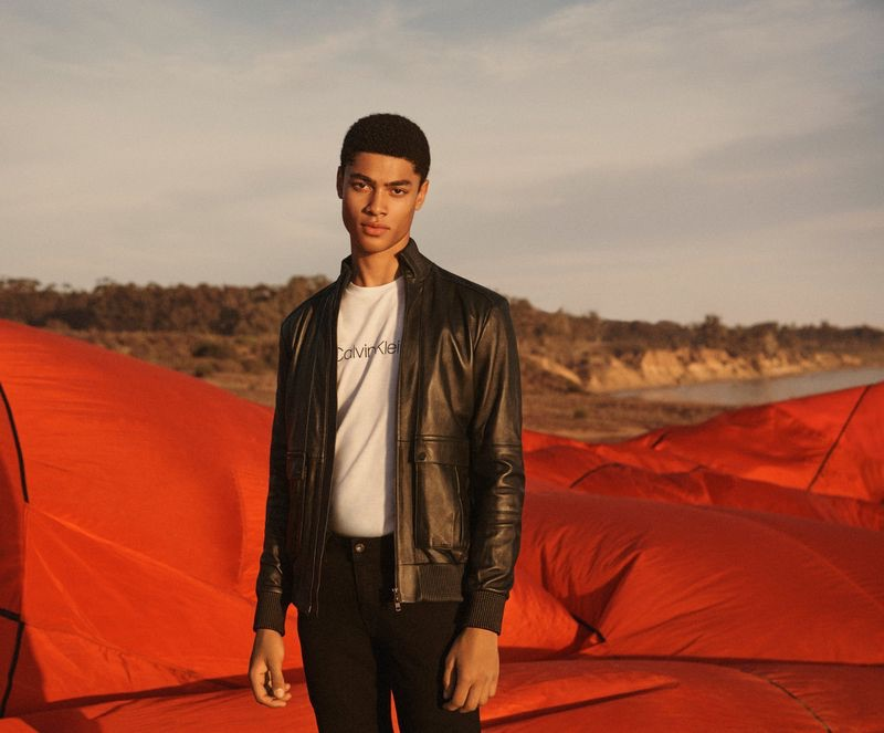 Sporting a leather jacket, Désiré Mia fronts Calvin Klein's spring-summer 2019 collection campaign.