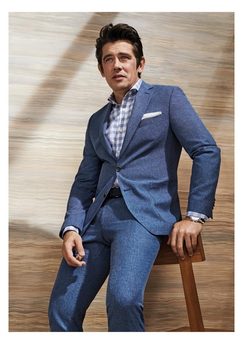 Model Werner Schreyer dons a blue suit from Carl Gross Black Line.