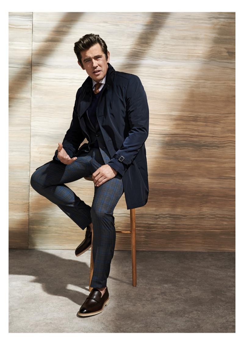 An elegant vision, Werner Schreyer wears tailoring by Carl Gross.