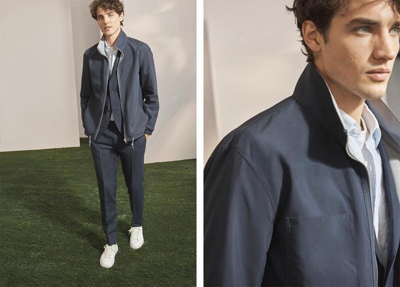 Embracing monochromatic style, Federico Novello wears a Club Monaco linen blazer, reversible track jacket, bandana shirt, linen trousers, and sneakers.