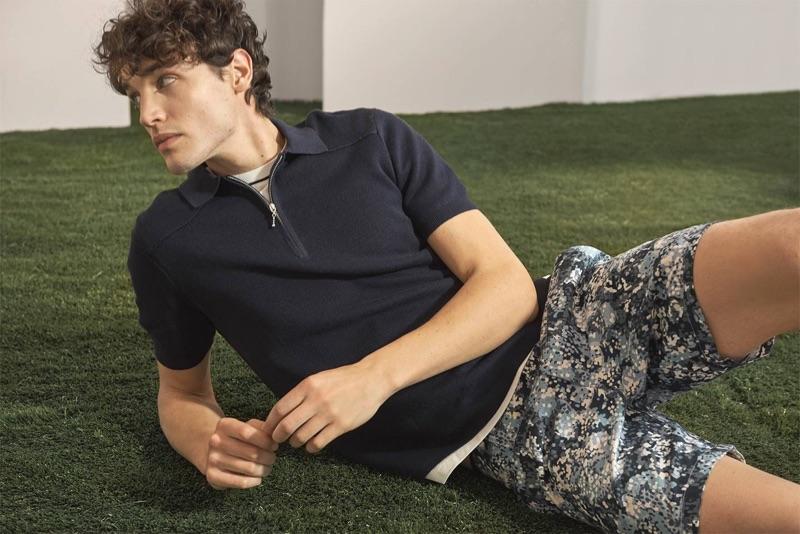 """Relaxing, Federico Novello sports a Club Monaco pique crewneck, polo, and """"Garden"""" shorts."""
