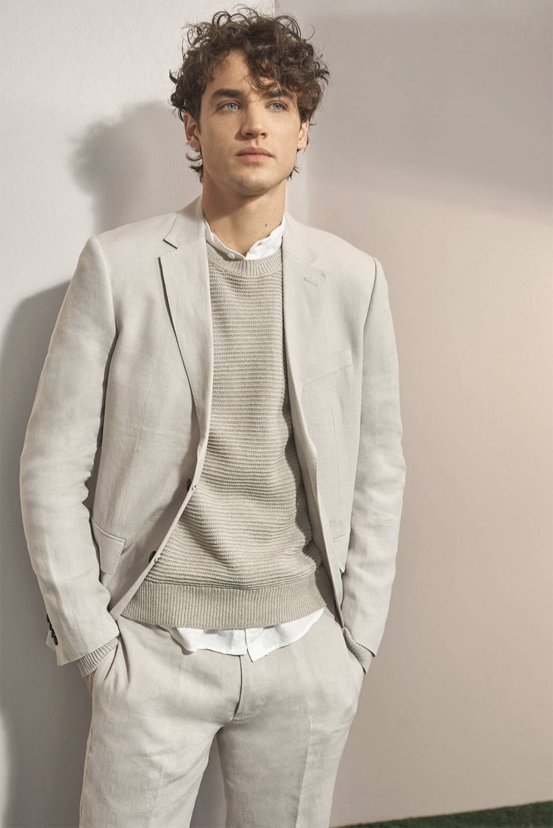 A chic spring vision, Federico Novello wears a Club Monaco linen blazer, crew, band-collar shirt, and trousers.
