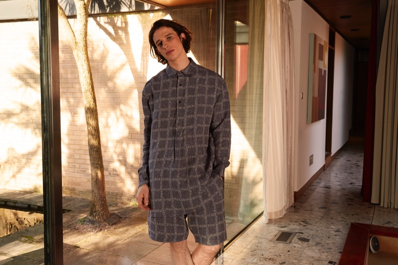Model Liam Gardner rocks a J.W. Anderson shirt and shorts for Coggles' spring-summer 2019 campaign.