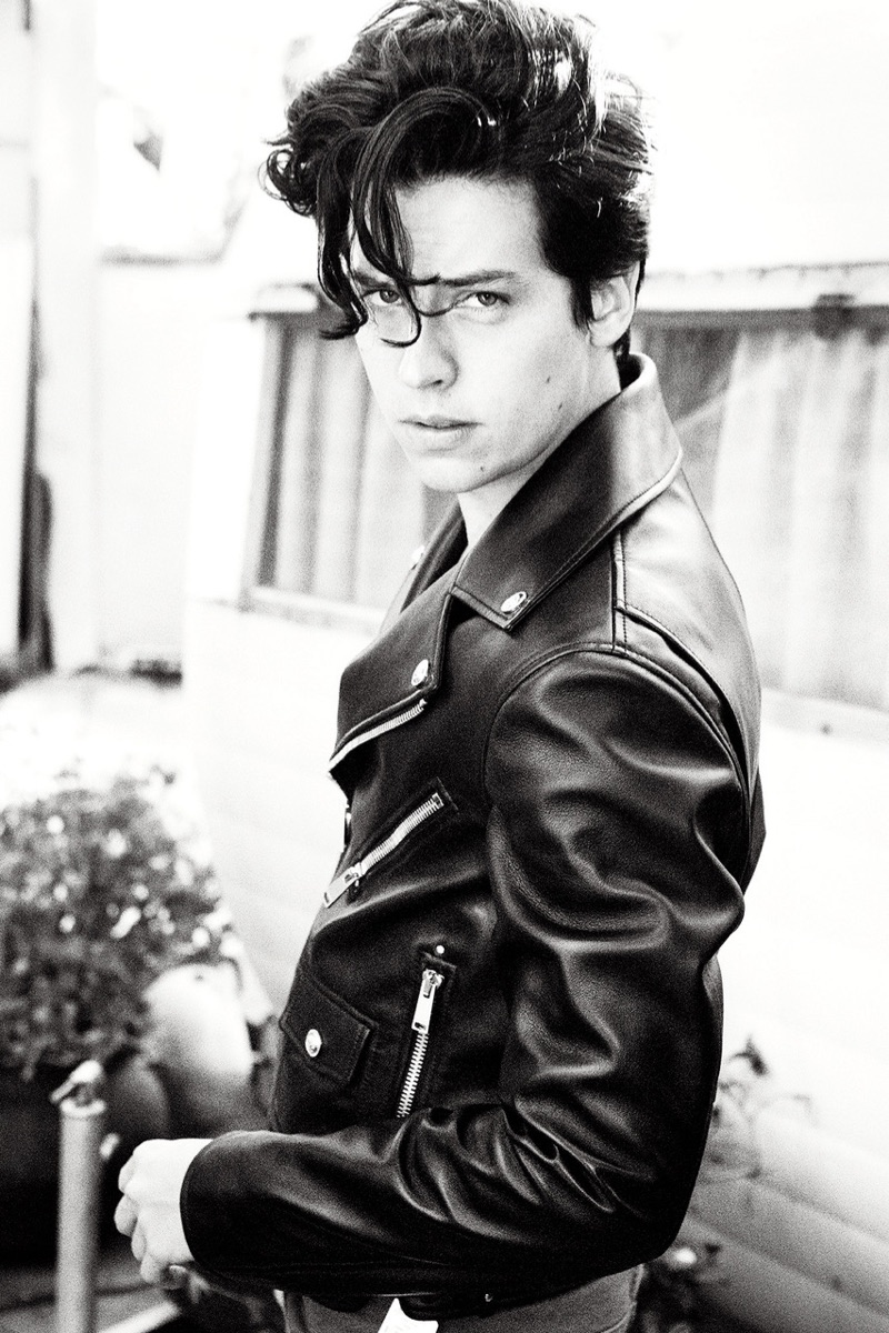 Channeling the 1950s, Cole Sprouse wears a Versace leather biker jacket with Balmain jeans.