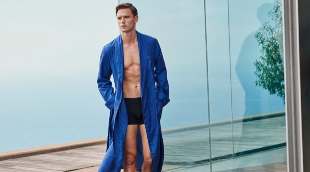 Guy Robinson dons a robe and underwear from Derek Rose's spring-summer 2019 collection.