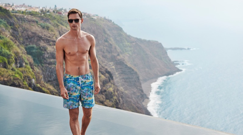 Embracing California vibes, Guy Robinson rocks swim shorts by Derek Rose.