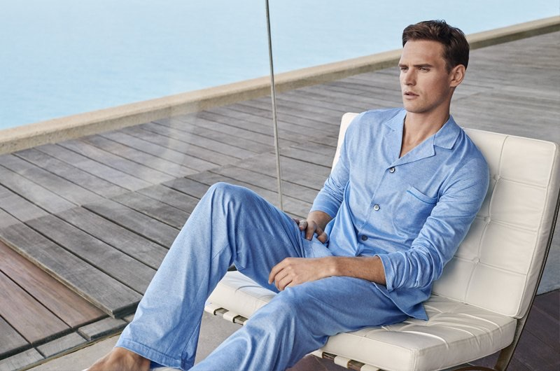 British model Guy Robinson dons luxury pajamas from Derek Rose.