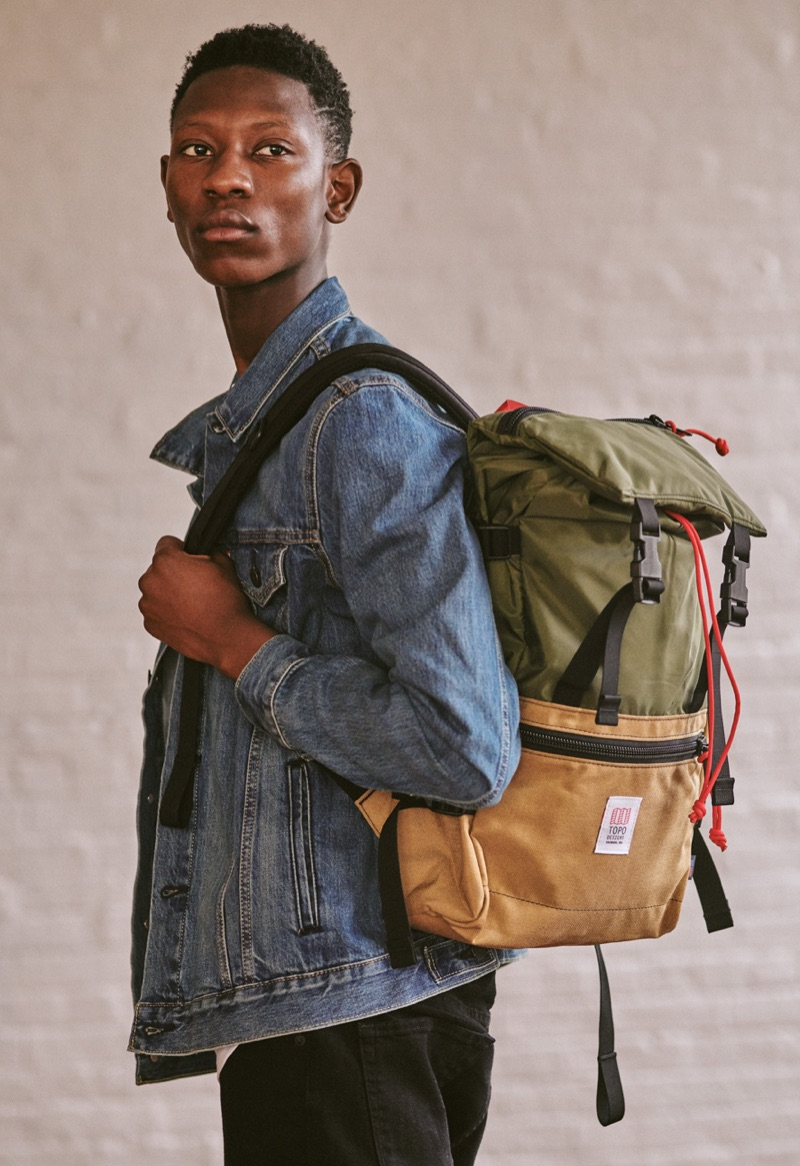 Going casual, Lang Jobe wears a LEvi's Red Tab denim jacket, Saturdays NYC tee, J Brand jeans, and a Topo Designs backpack.
