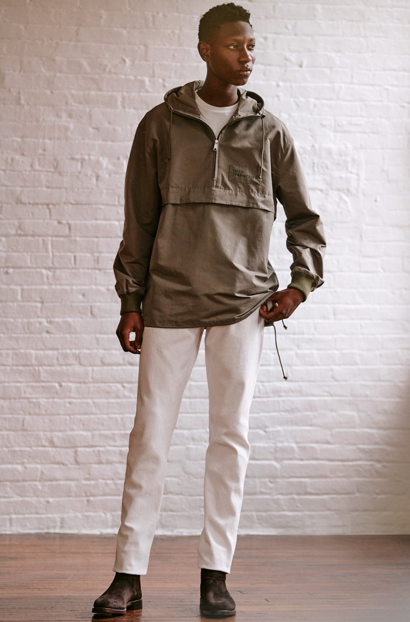Front and center, Lang Jobe rocks a Halo anorak, Helmut Lang jeans, Stüssy tee, and Allen Edmonds suede Chelsea boots.