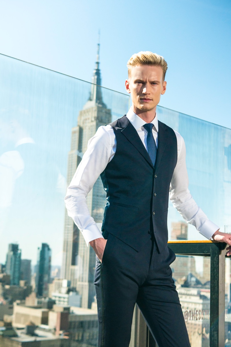 Alexander Johansson sports a sleek waistcoat, shirt, and trousers by Enzo Custom.