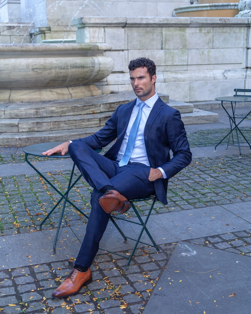 Dressed to impress, Walter Savage models a blue suit by Enzo Custom.