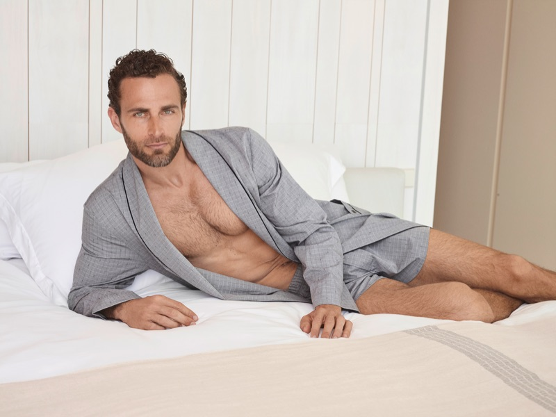 Lounging, Christian Santamaria wears Hanro's 100% woven mercerized cotton chambray Theo robe and fancy woven boxers.