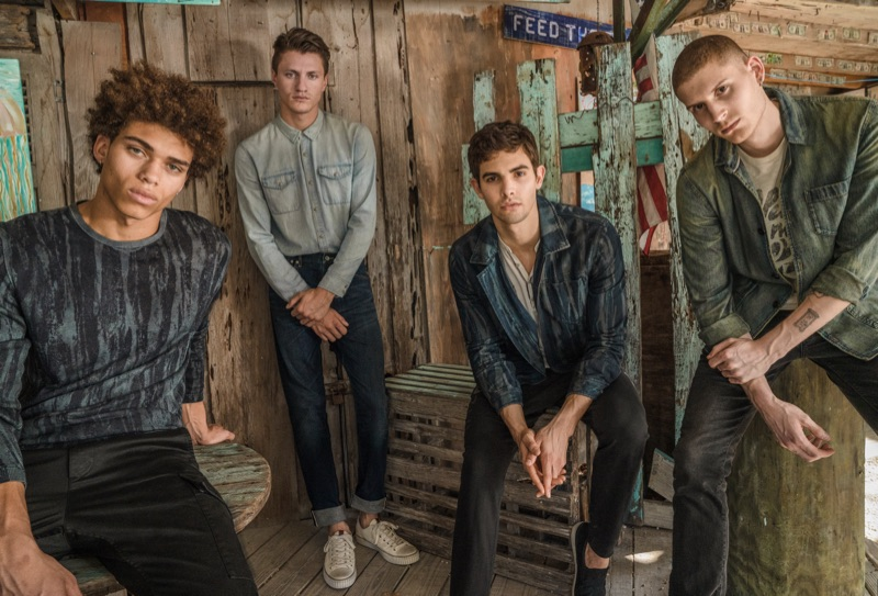 Models Ikce-Wicasa Quiles, Eli Hall, Gordon Winarick, and Mike Russo rock denim from John Varvatos Star USA.