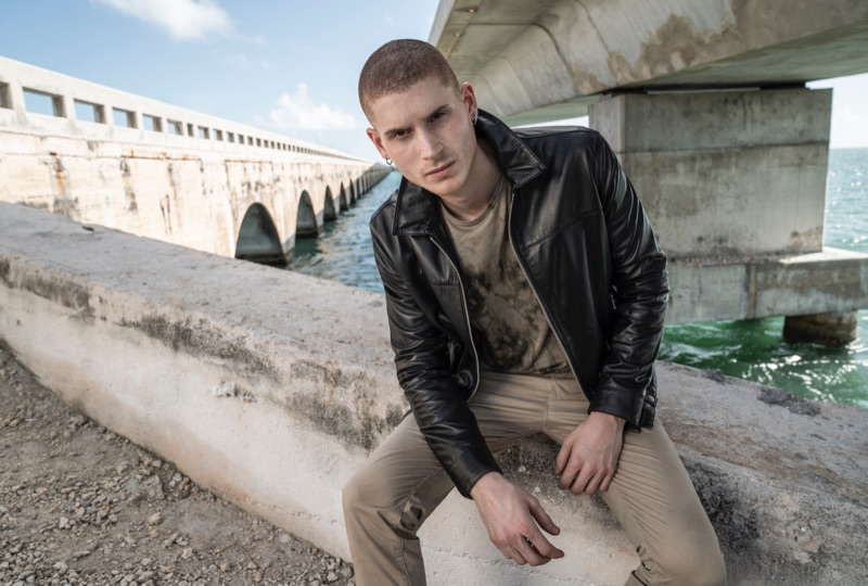A cool vision, Mike Russo rocks a leather jacket and khaki pants by John Varvatos Star USA.