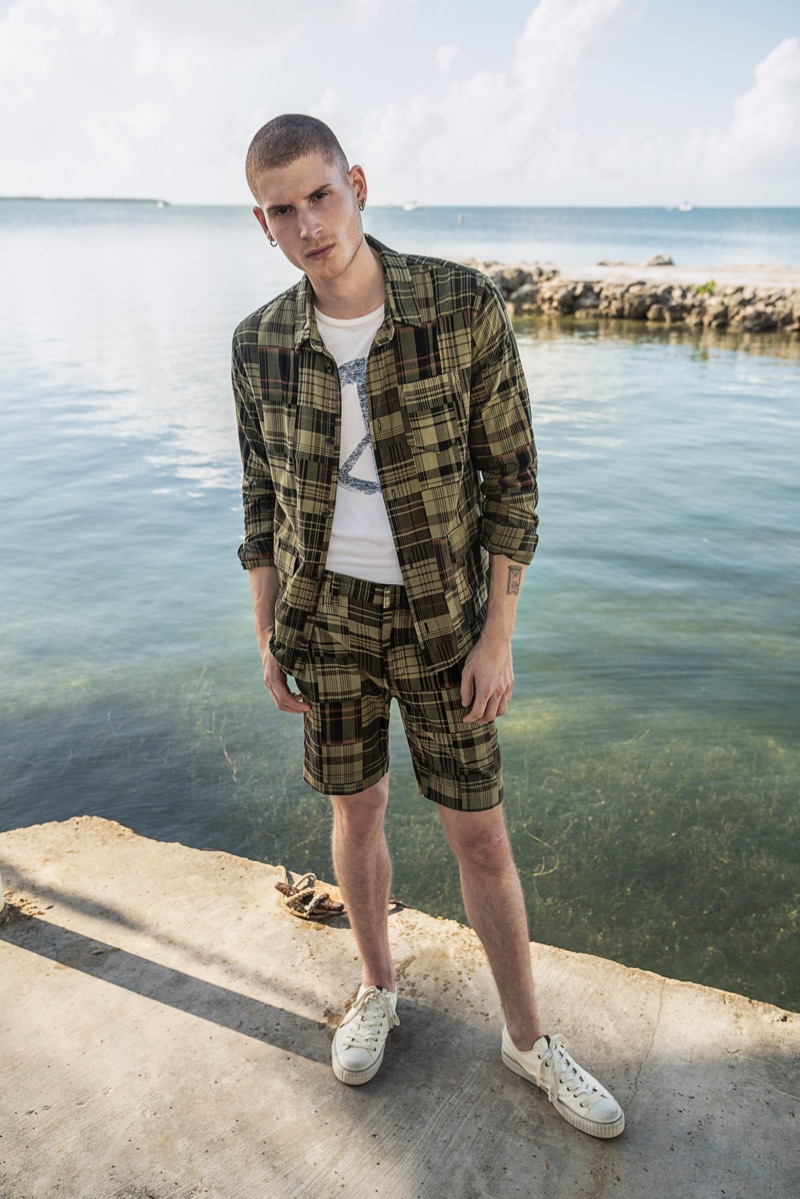 Mad for plaid, Mike Russo sports a matching shirt and shorts from John Varvatos Star USA.
