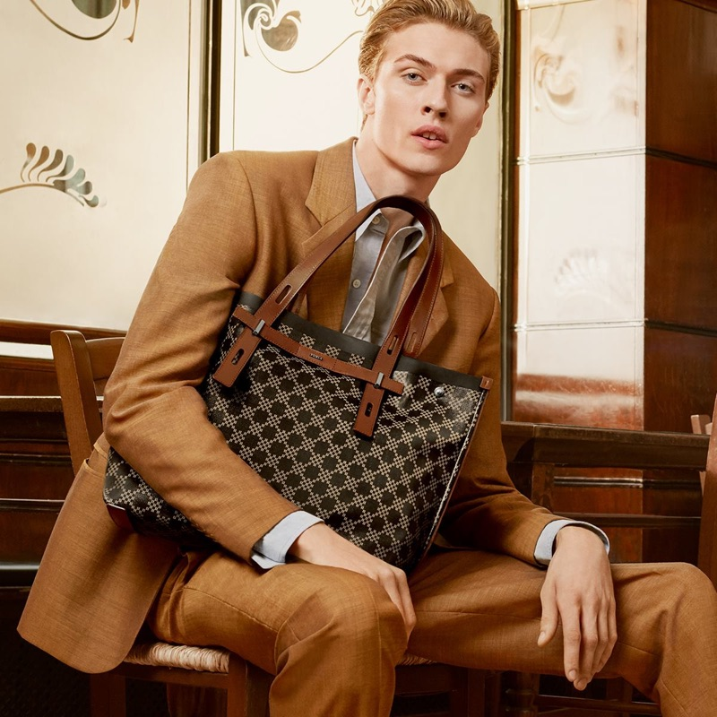 Lucky Blue Smith poses with the Furla Giove bag for the brand's spring-summer 2019 campaign.