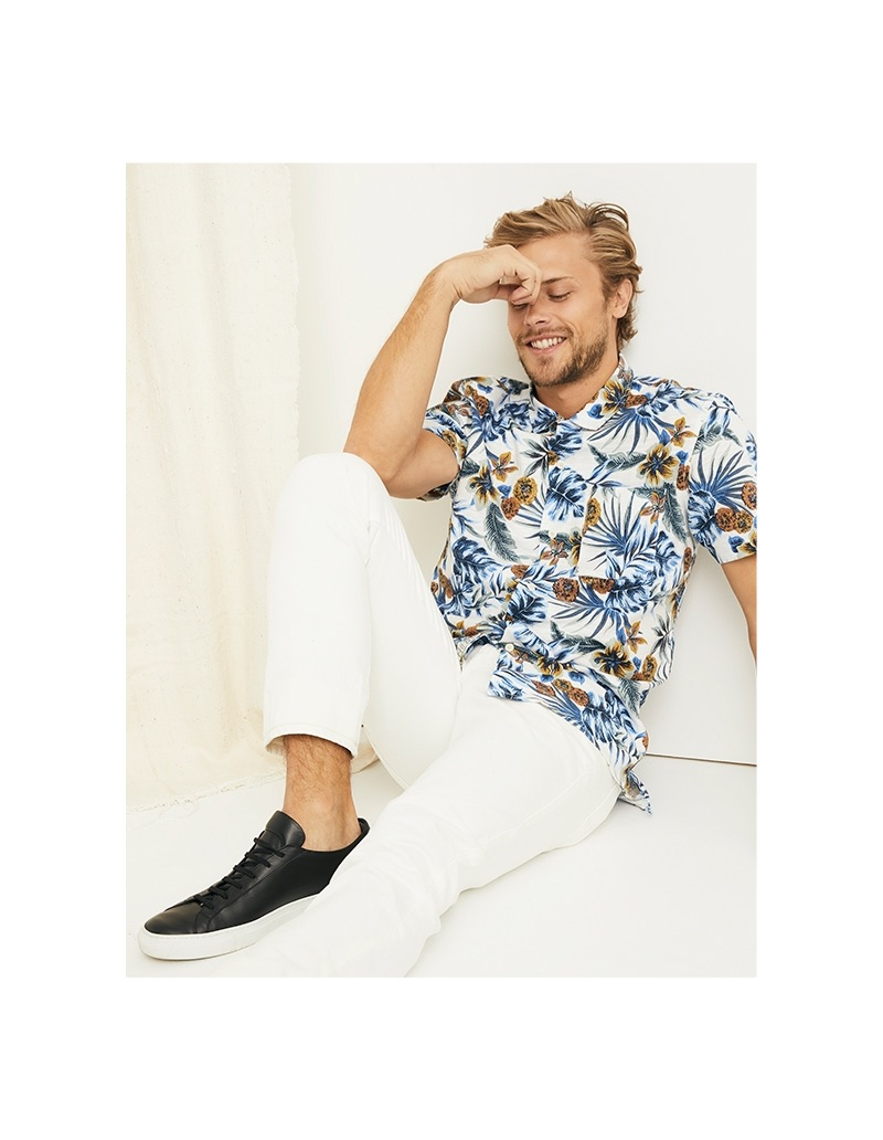 All smiles, Christopher Mason rocks a Lucky Brand floral print shirt and 110 skinny white pants.