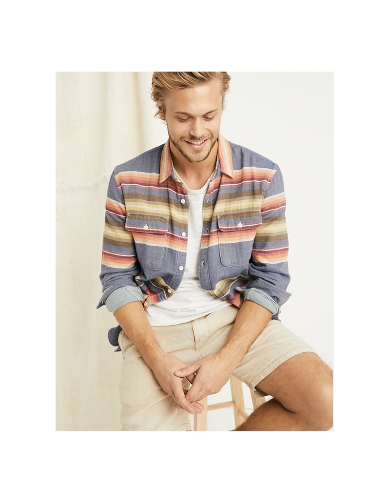 Embracing a casual spring look, Christopher Mason dons a Lucky Brand stripe shirt, linen one pocket tee, and linen shorts.
