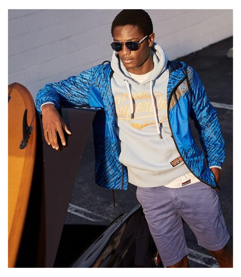 Hamid Onifade sports a Superdry logo graphic hoodie and jacket.