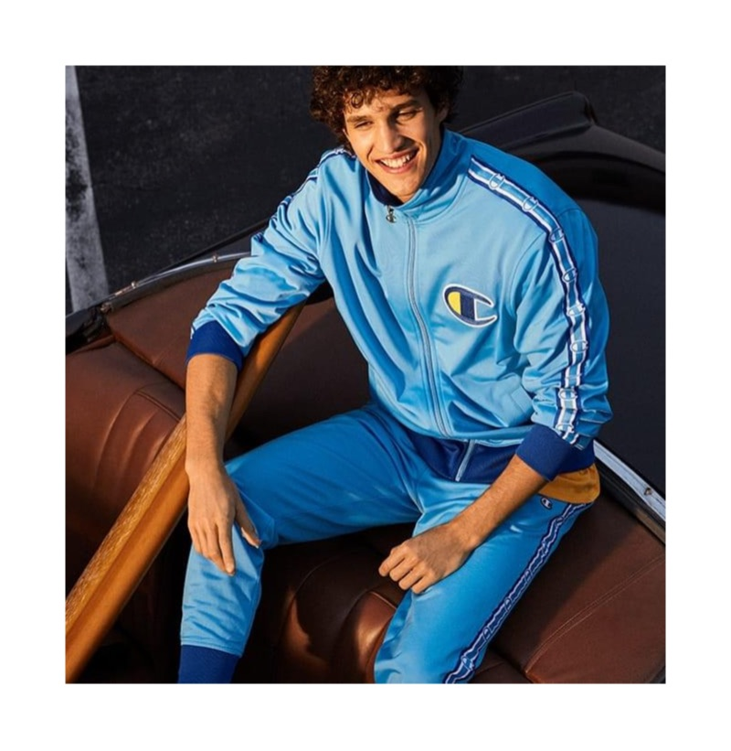 All smiles, Francisco Henriques wears a Champion track jacket and pants.