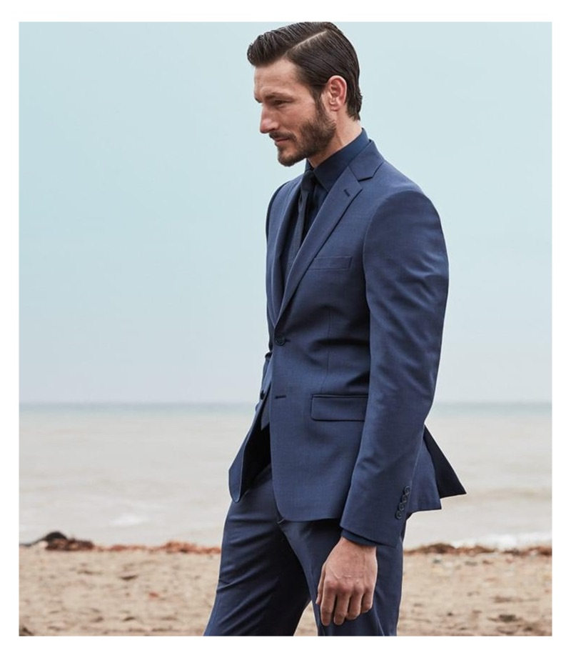 Model Parker Gregory dons a skinny-fit suit jacket and pants from Calvin Klein.