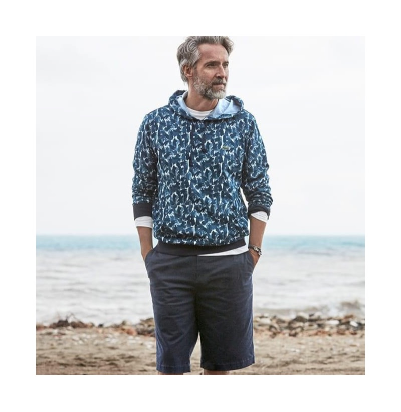 Ben Desombre sports a Lacoste printed hoodie with Bermuda shorts.