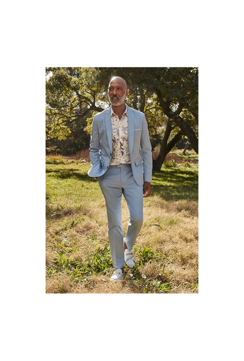 Lono Brazil dons a pastel suit by I.N.C.