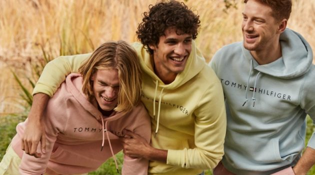 Hunter Bach, Francisco Henriques, and Race Imboden sport pastel hued hoodies from Tommy Hilfiger.