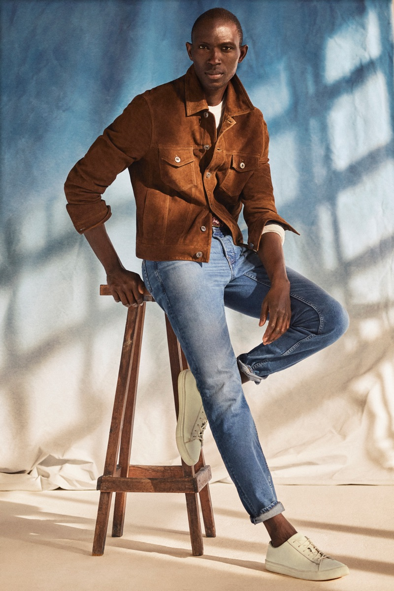Light Denim: Armando Cabral sports a vintage-style jacket in brown suede with a light pair of Tim jeans from Mango.