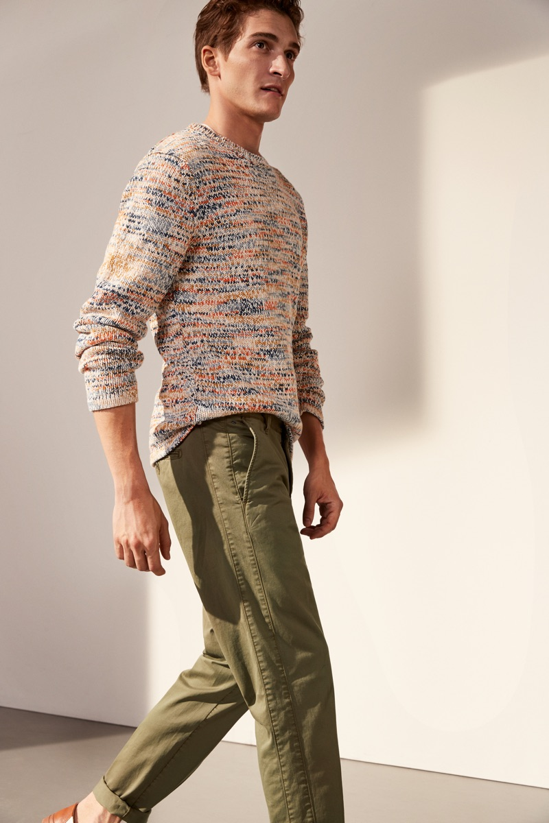 Embracing spring fashions, Matvey Lykov wears Marc O'Polo's marle sweater and slim-fit pants.