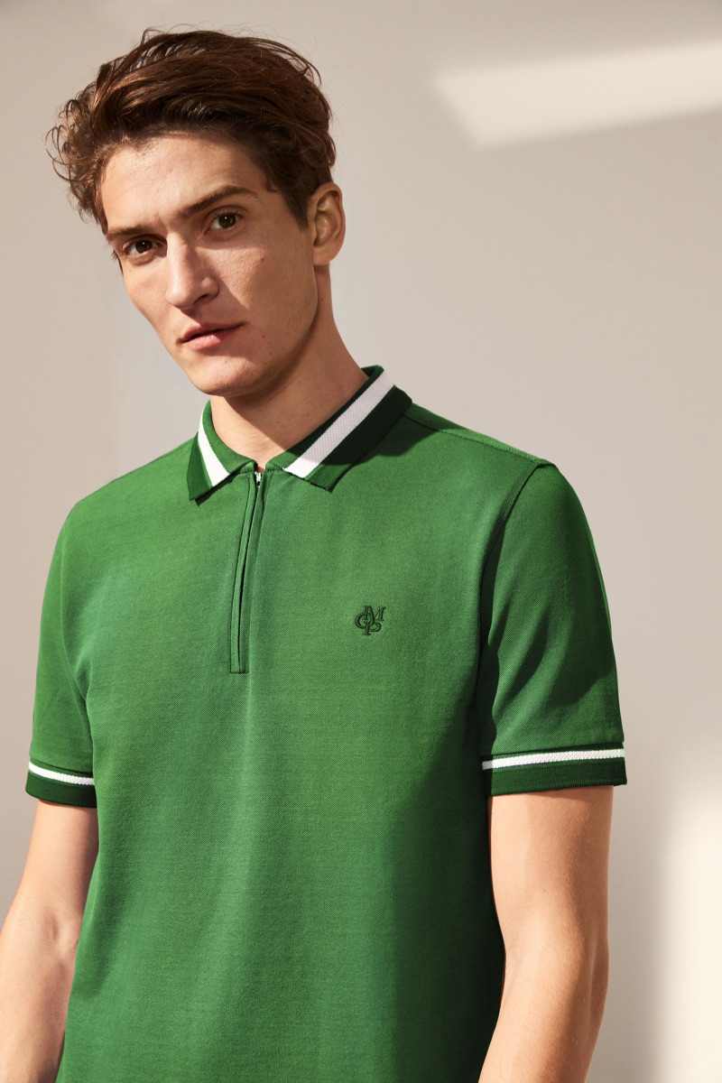 Connecting with Marc O'Polo for spring, Matvey dons a green zippered polo.