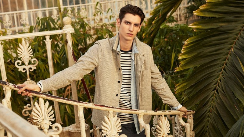 Anthony Gilardot wears a striped slub jacket, jersey t-shirt, shorts, and linen shirt by Mr P.
