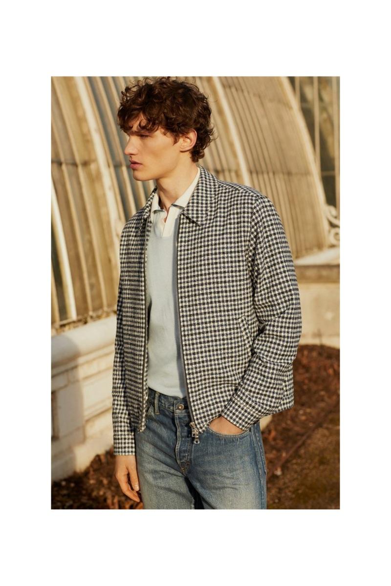 Lukas Marschall dons a Mr P. bouclé jacket, piqué polo shirt, and selvedge denim jeans.