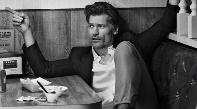 Actor Nikolaj Coster-Waldau sports a Sandro shirt, Prada suit jacket, Moncler 2 pants, and Lanvin sneakers.