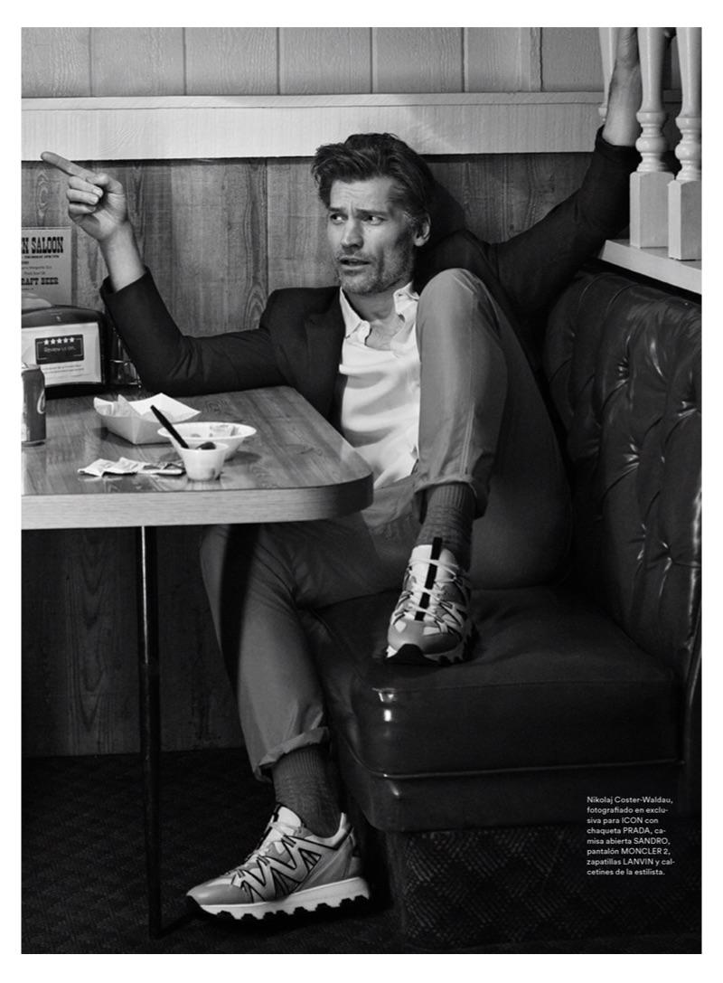 Actor Nikolaj Coster-Waldau sports a Sandro shirt, Prada suit jacket, Moncler 2 pants, and Lanvin sneakers.