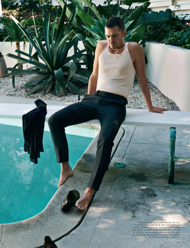 Starring in a photo shoot, Orlando Bloom wears a Tom Ford tank and trousers.