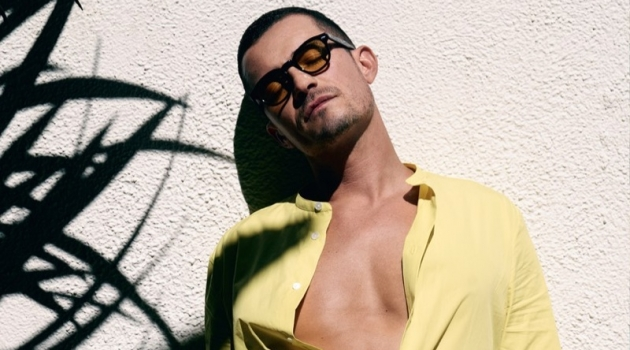 Orlando Bloom wears a Hermès shirt with Stella McCartney boxer shorts and Moscot sunglasses.