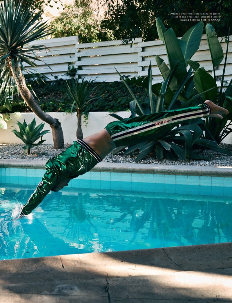 Going for a dip, Orlando Bloom sports a Gucci laminated tracksuit.