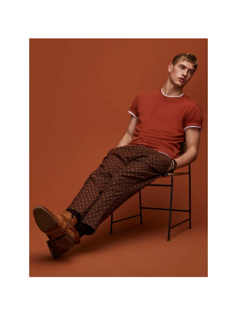 Paul François dons a Scotch & Soda t-shirt with jacquard chinos.