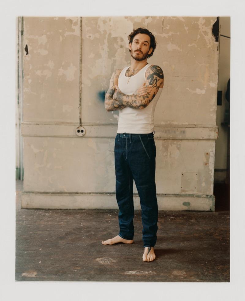 Sporting a tank, David Alexander Flinn shows off a pair of jeans from Rag & Bone.