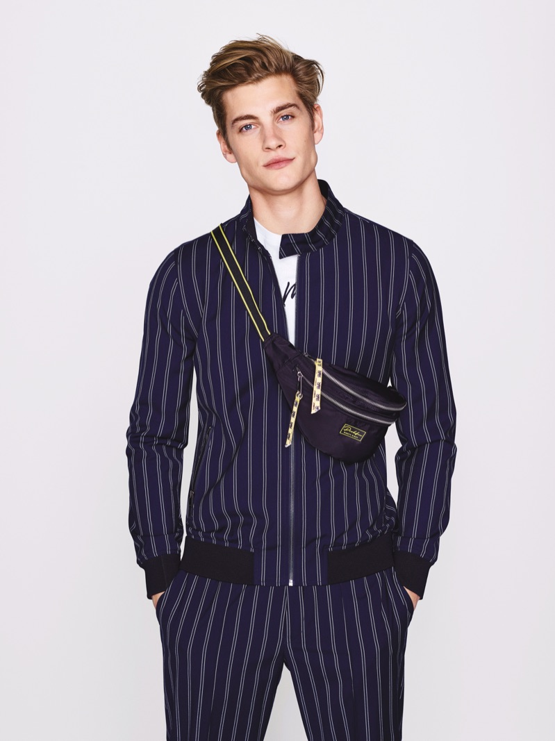 Front and center, Rob Knighton rocks a pinstripe number in navy from River Island.