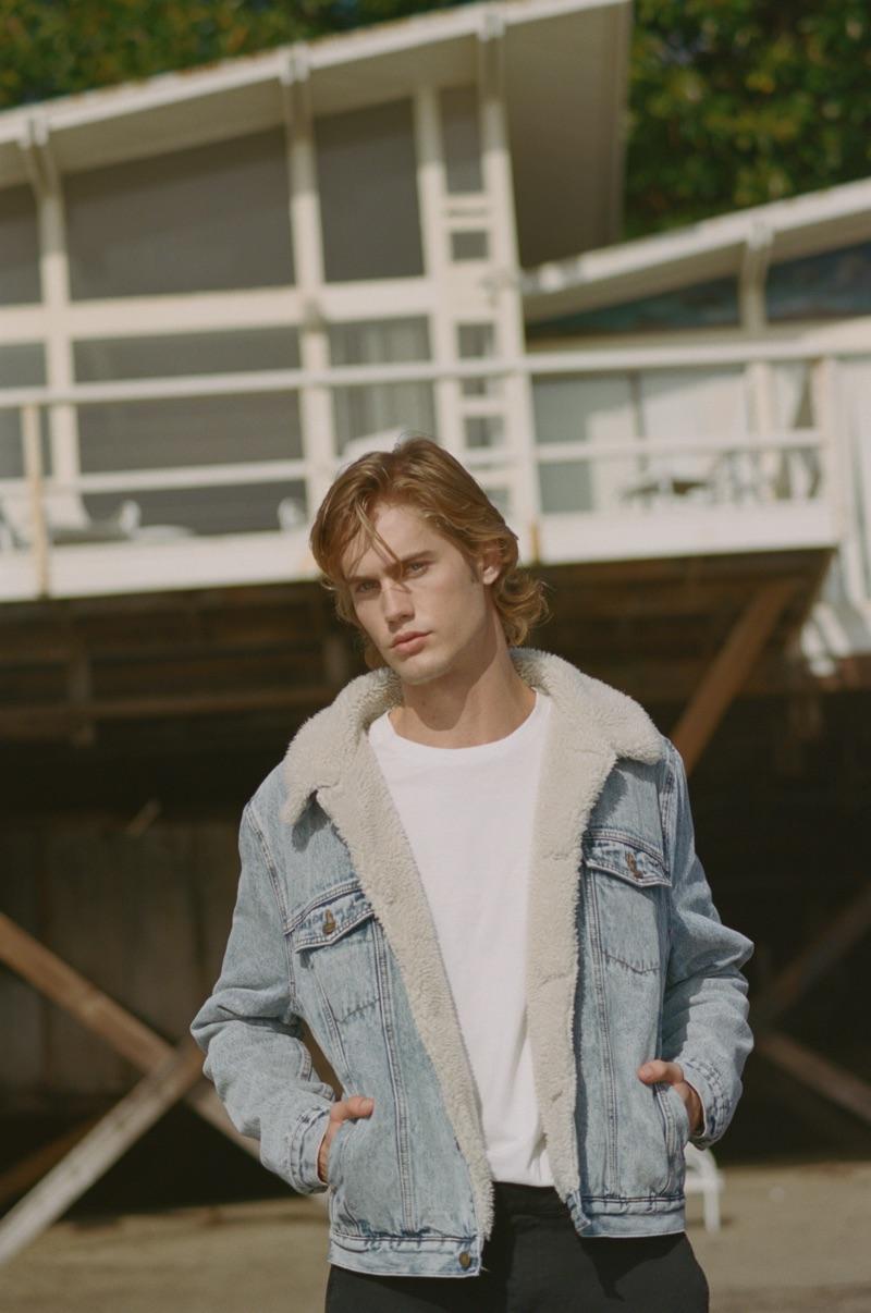Sporting a denim jacket, Neels Visser stars in Rolla's spring 2019 campaign.
