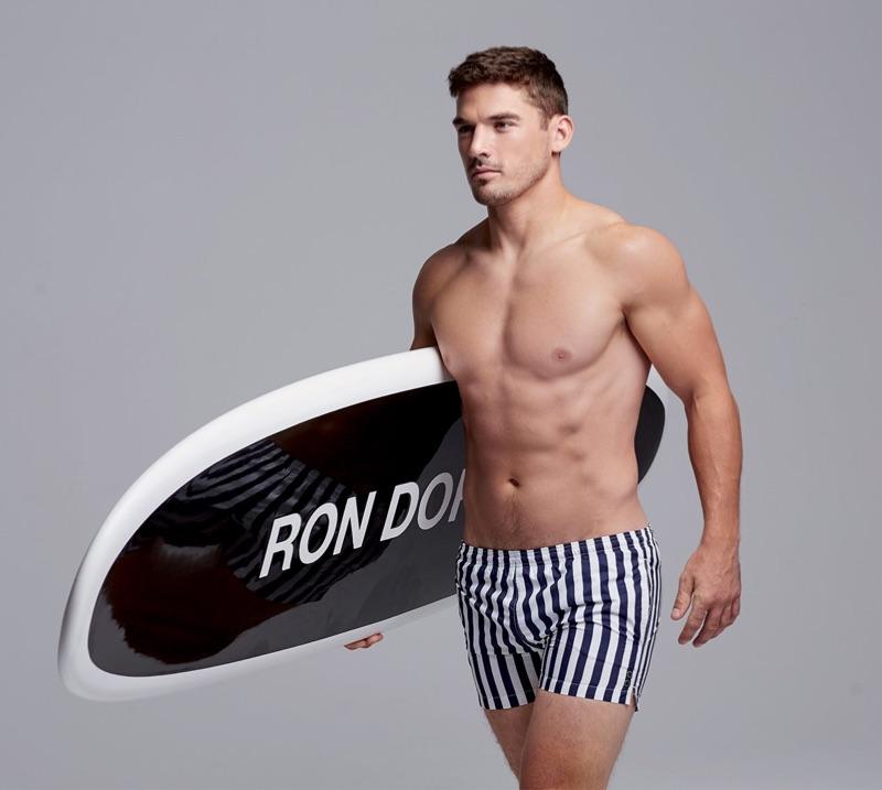 Sporting striped swim shorts, Kerry Degman wears Ron Dorff.